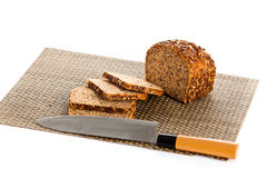 Loaf of wholemeal bread  cutting into slices on wood bread board Stock Photography
