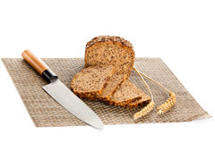 Loaf of wholemeal bread  cutting into slices on wood bread board Royalty Free Stock Photo