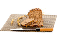 Loaf of wholemeal bread  cutting into slices on wood bread board Stock Image