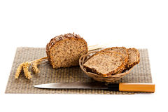Loaf of wholemeal bread  cutting into slices on wood bread board Stock Photos