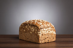 Loaf of wholemeal bread on table Stock Photos