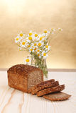 Loaf with wild flowers Royalty Free Stock Image