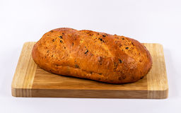 Loaf on a wooden serving board Stock Photography