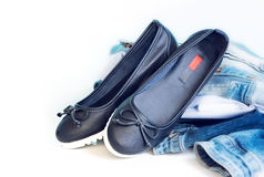 Loafers sleep on female shoes on white background. Stock Photos