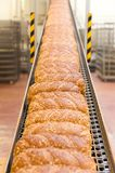 Loafs of bread in the factory. Loafs of bread being made in a factory Royalty Free Stock Image