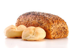 Loafs of bread and rolls. Isolated on white background Stock Images