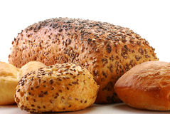 Loafs of bread and rolls. Isolated on white background Stock Photo