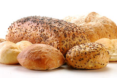 Loafs of bread and rolls. Isolated on white background Royalty Free Stock Photos