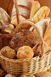 Loafs of bread and rolls in wicker baskets Royalty Free Stock Photo