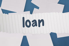 Loan against white paper strewn over blue Stock Photo