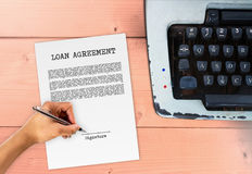 Loan agreement with hand signing signature. Vintage contract typewriter Royalty Free Stock Images