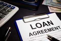 Loan agreement and money. Loan agreement and money in an office stock photography