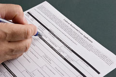 Loan Application. Man filling out a residential home loan application Stock Photos