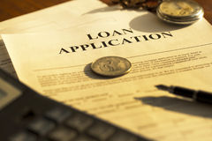 Loan Application. Form or document in bank office showing finance concept royalty free stock photography
