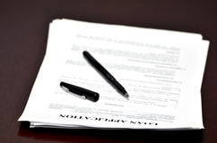Loan Application on Desk Royalty Free Stock Images