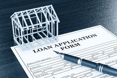 Loan Application Form with House Frame and pen Royalty Free Stock Images