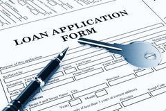 Loan Application Form with House Key and pen Royalty Free Stock Photography