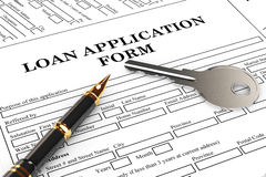 Loan Application Form with House Key and pen. On the table stock photography