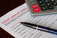 Loan application. Form with pen and calculator Royalty Free Stock Images