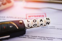 Loan approval / financial loan application form for lender and borrower for car with key and calculator. On the table office stock image