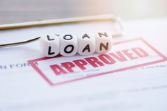 Loan approval / financial loan application form for lender and borrower for help investment bank estate. Concept royalty free stock image