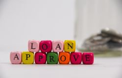 Loan Approve with colourful alphabet on white background royalty free stock image