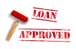 Loan Approved. Red ink with ink roller Stock Photo