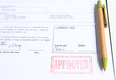Loan approved stamp. On white document Royalty Free Stock Photography