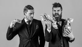 Loan and banking concept. Men in suit, businessmen with jar full of cash and credit card, pink background. Mature man on. Loan and banking concept. Men in suit stock images
