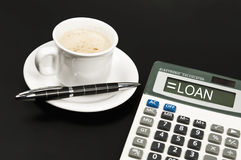 Loan on calculator Royalty Free Stock Photos