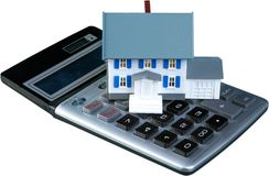 Model of a House on Calculator - Isolated. Loan calculator currency real estate credit house prices house lease Royalty Free Stock Photo