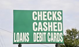 Loan and Check Cashing Business. An advertisement sign from a loan and check cashing business Stock Images