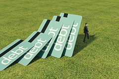 Loan concept. Blue debt cards falling onto thoughtful businessman standing on grass. Loan concept. 3D Rendering royalty free stock photos