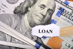 Loan concept with dollar note and paper on foreground Stock Photos