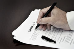 Loan Contract Document on Desk with Black Pen Royalty Free Stock Photo