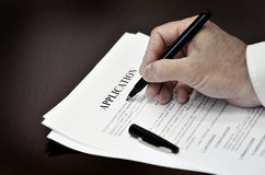 Loan Contract Document on Desk with Black Pen Royalty Free Stock Photos