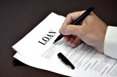 Loan Document Agreement on Desk with Pen. Loan document and agreement with pen for signing Stock Photo
