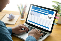 Loan Financial Application Form Filling the form of business credit application royalty free stock photography