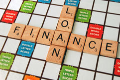 Loan Financing. The words loan and finance on a scrabble board stock photos