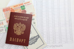 Loan repayment schedule and passport. The schedule of payments on the loan and the Russian passport Royalty Free Stock Images