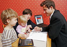 Loan series. Bank manager with mother and her two children wanting a loan royalty free stock image
