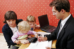 Loan series. Bank manager with mother and her two children wanting a loan royalty free stock photography