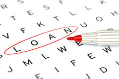 Loan in solving crossword puzzle Royalty Free Stock Photography