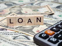 LOAN in wooden block Stock Images