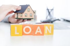 LOAN word with colorful blocks. Loan word debt forecasting money financial cube repaying concept royalty free stock photography