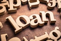 Loan Word on Table. LOAN word by wood alphabet scattered on the table stock images