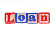 LOAN written with old wooden blocks Stock Image