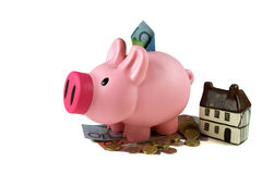 Loans Money for Australian Finance. Piggy bank or money-box with money, Australia dollar and coins with a small house. Loans and saving apply, Australian finance Stock Image
