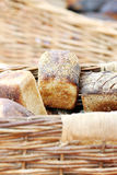 Loaves in Baskets. Small loaves of homemade bread in baskets royalty free stock photo