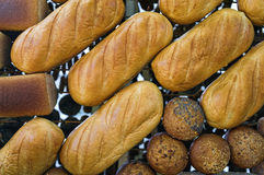 Loaves of bread. Put out at grocery stand royalty free stock photo